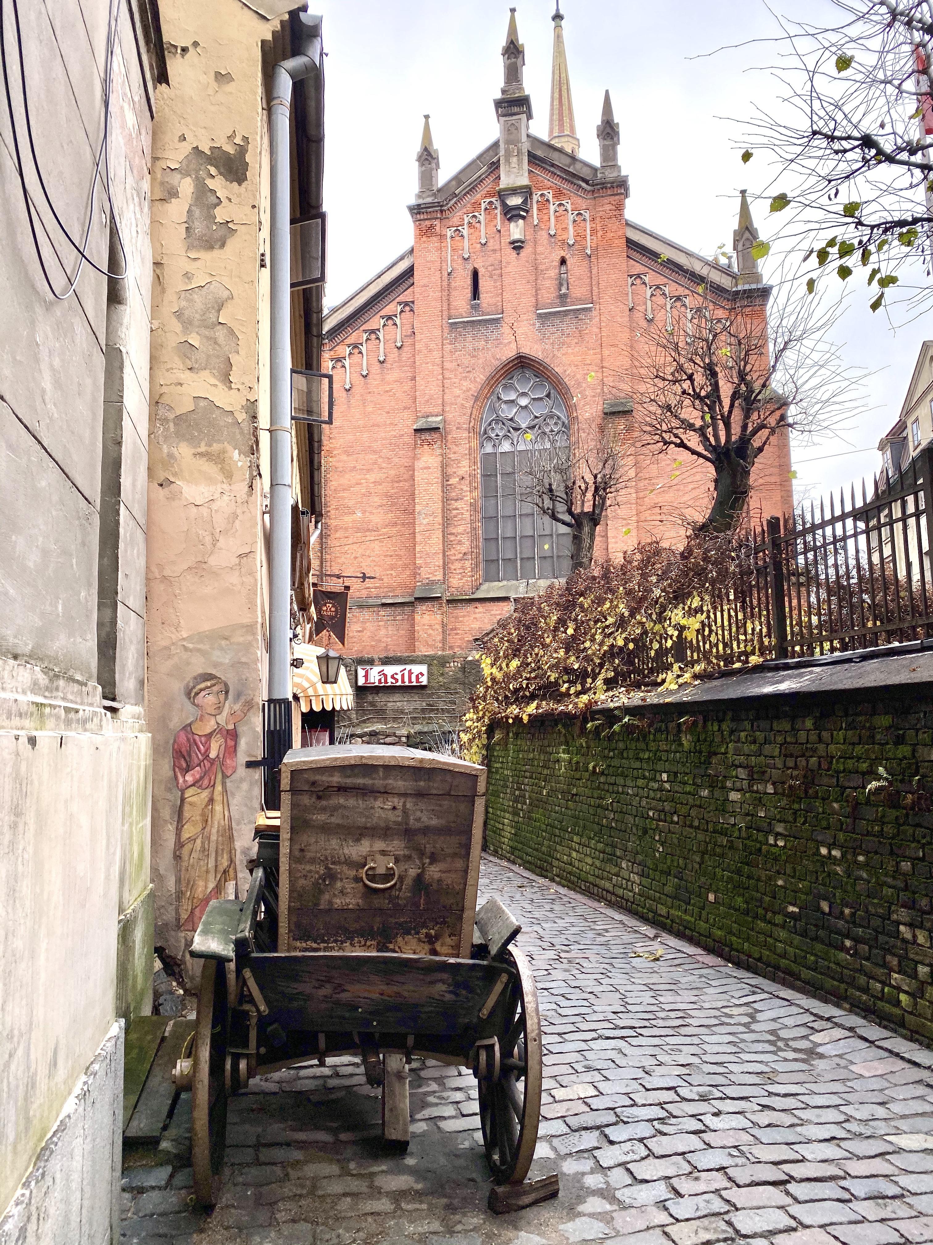 A pretty alley with a wagon in Riga, Latvia.
