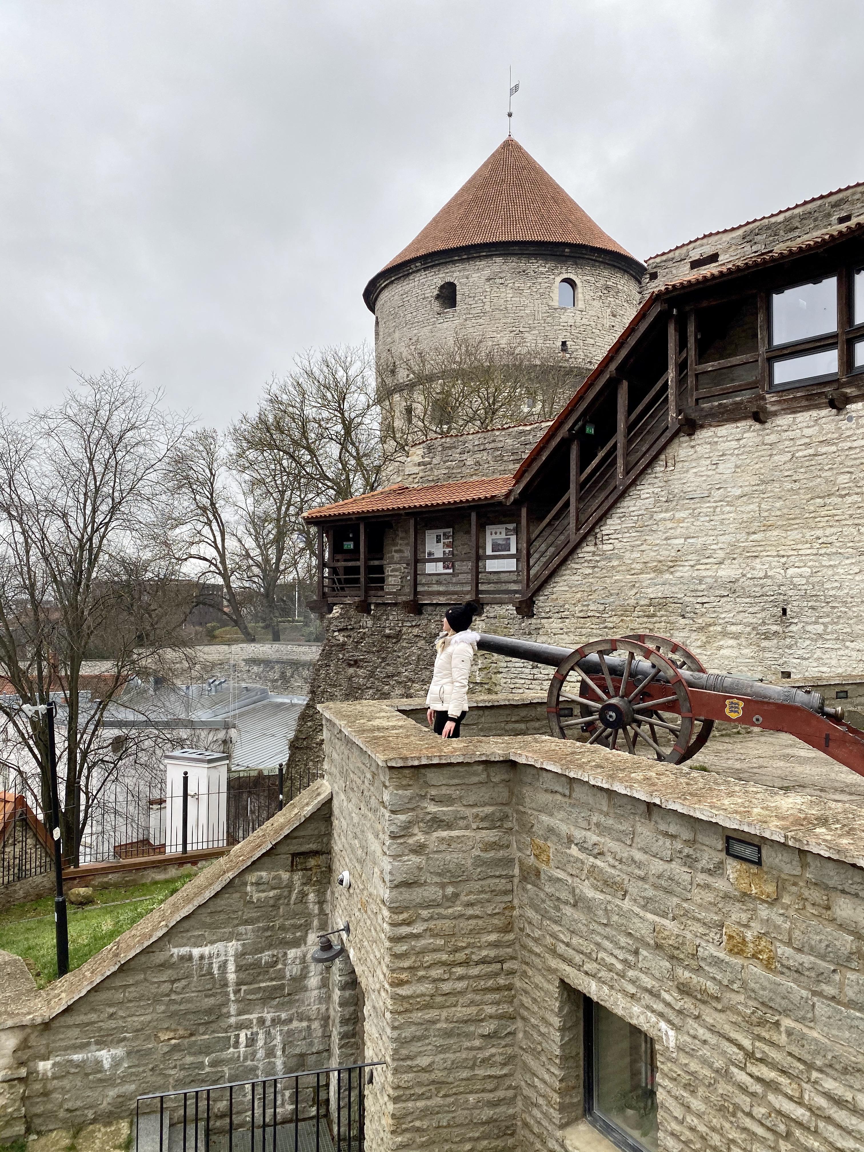 Erinn standing by a cannon at the Danish King's Garden in Tallinn, Estonia.