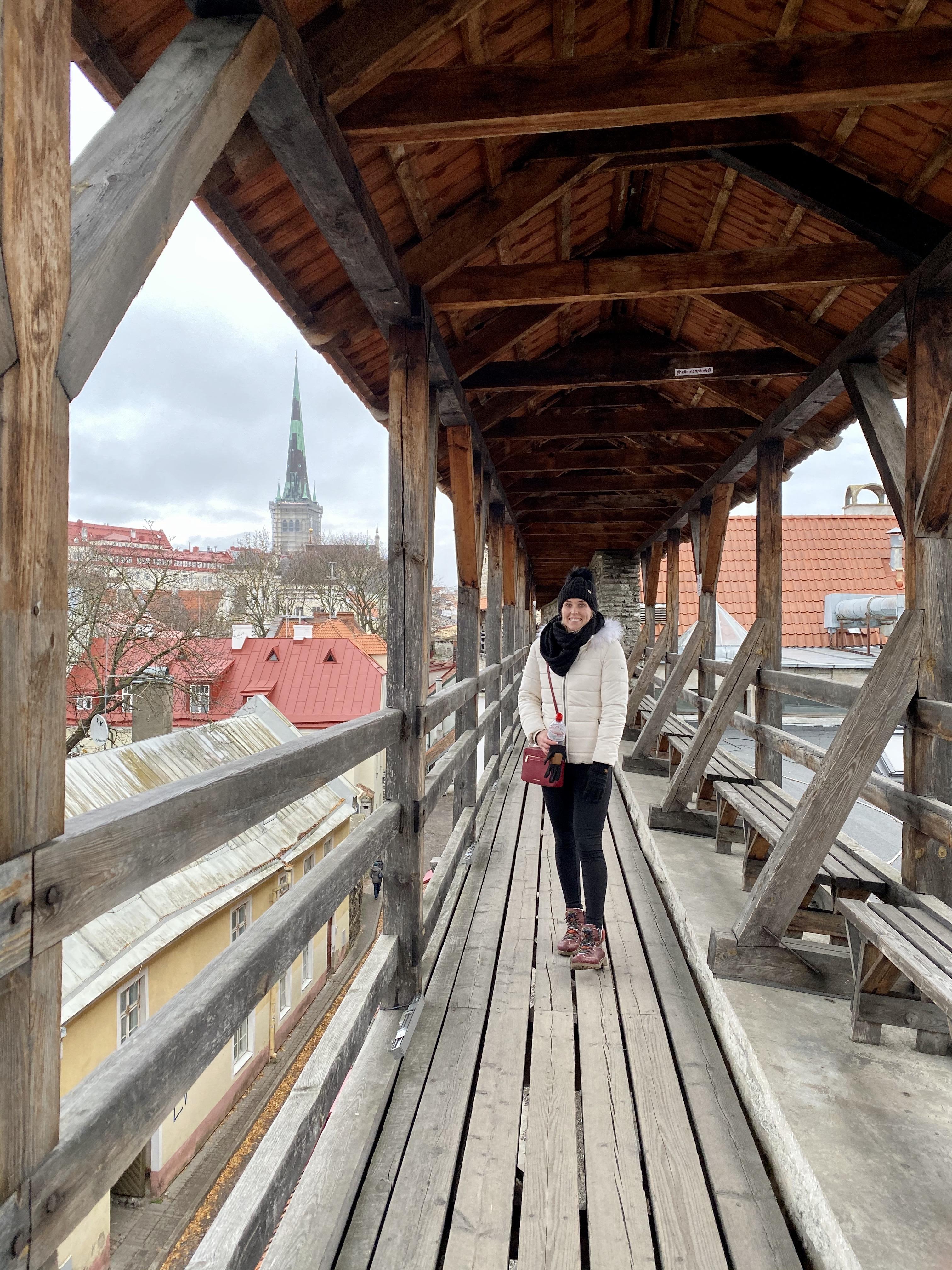 Erinn walking along the medieval city walls of Tallinn, Estonia.