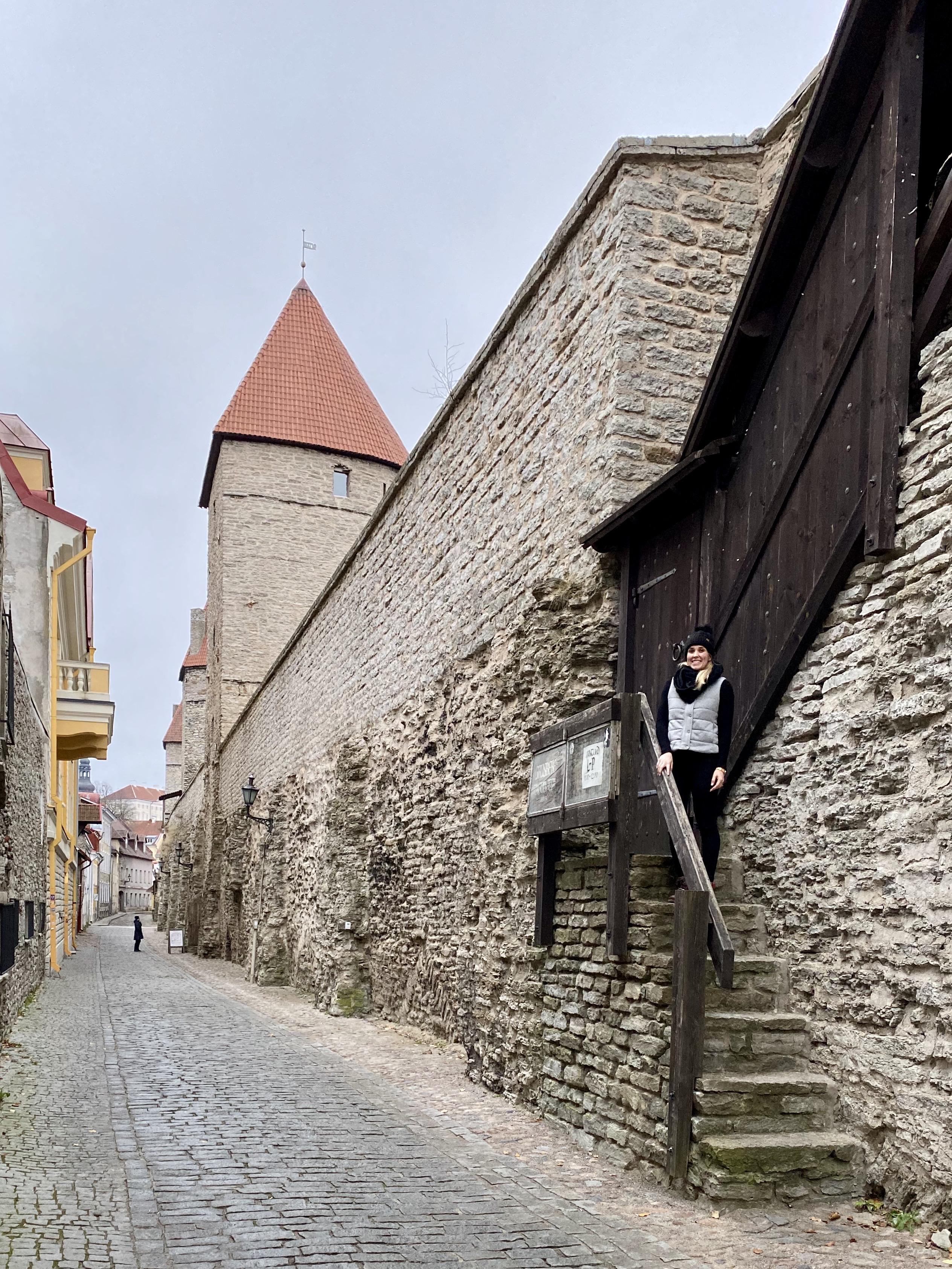 Erinn standing alongside the medieval city walls of Tallinn, Estonia.