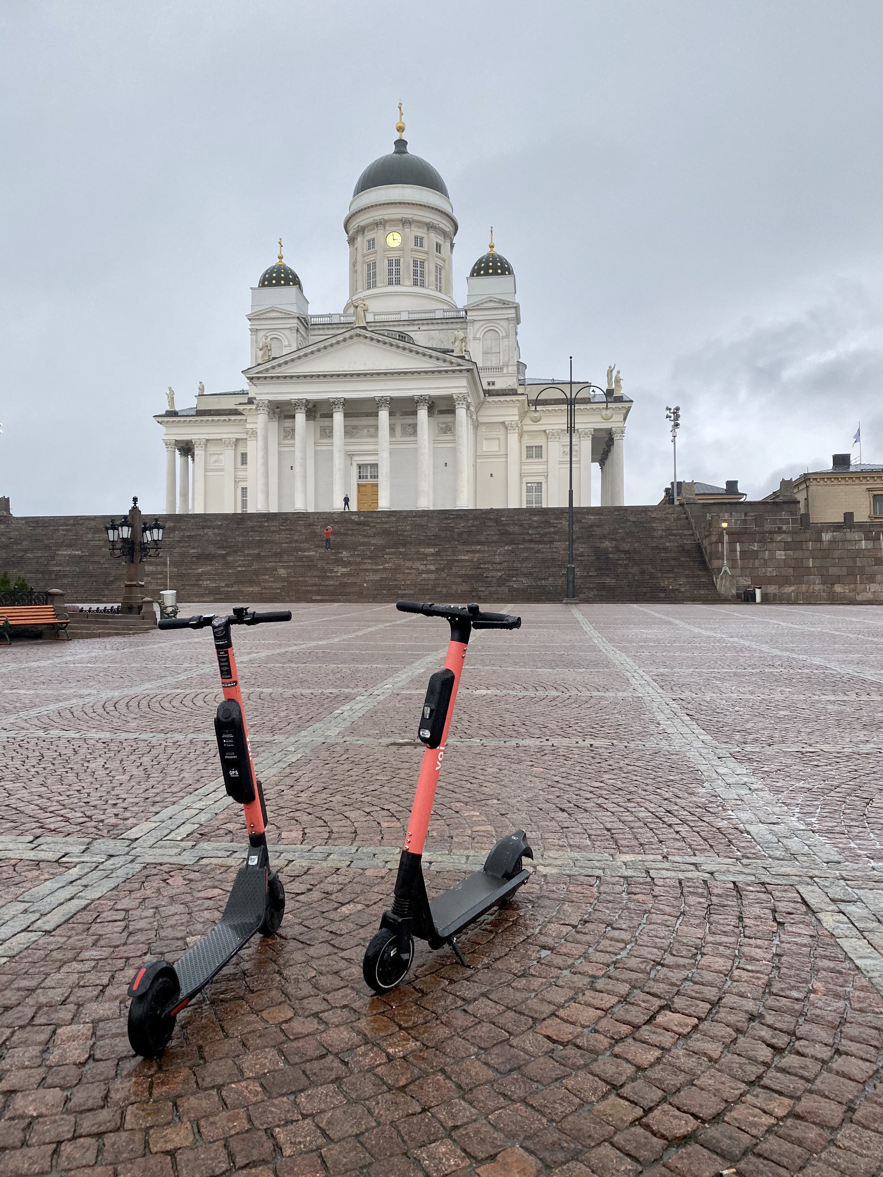 Voi e-scooters in front of Helsinki Cathedral.
