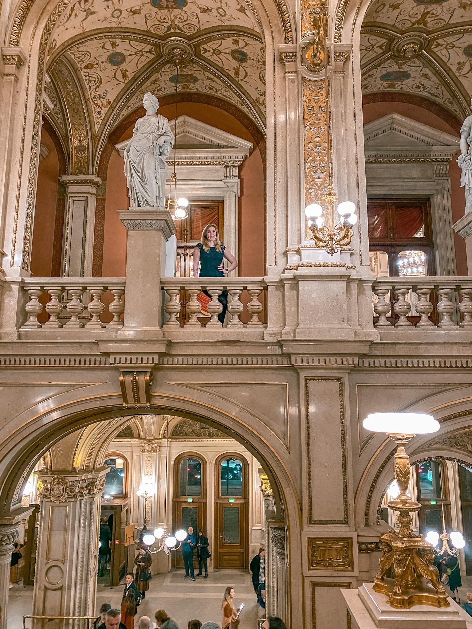 Erinn in the beautiful interior of Wiener Staatsoper (Vienna State Opera House).
