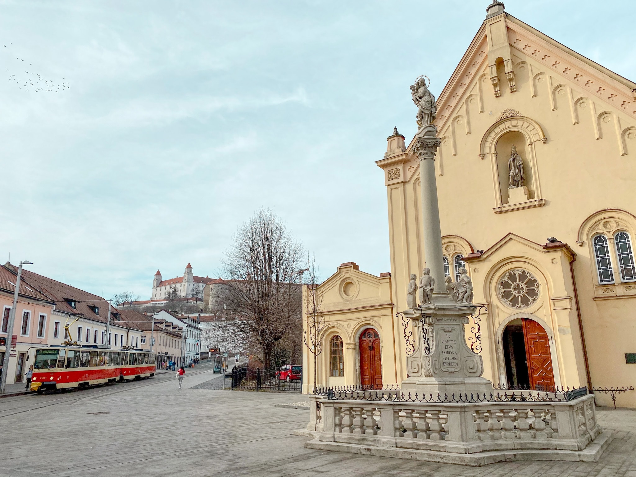 A view of Bratislava, Slovakia, with Bratislava Castle in the distance.